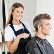 Stock Photo: Hairstylist Giving Haircut To Customer