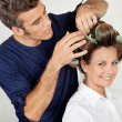 Stock Photo: Customer With Hairstylist Curling Hair At Parlor
