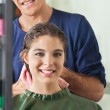 Male Hairdresser Wiping Client's Hair — Stock Photo