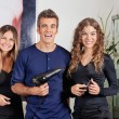 Happy Hairstyling Team At Beauty Parlor - Stockfoto