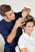 Customer With Hairstylist Curling Hair At Parlor — Stock Photo