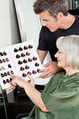 Client And Hairdresser Selecting Hair Color — Stock Photo