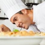 Male Chef Garnishing Dish — Stock Photo