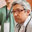 Male Doctor Looking Away — Stock Photo #21415683