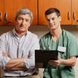 Medical Resident with Doctor — Stock Photo #21416105