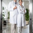 Medical Professionals Standing At Hospital Entrance — Stock Photo