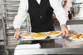 Waiter Holding Pasta Dishes In Tray — Stock Photo