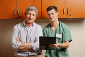 Medical Resident with Doctor — Stock Photo
