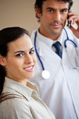 Woman Smiling While Doctor Standing In Background — Stock Photo