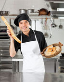 Male Chef Holding Bread Loaf — Stock Photo