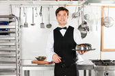 Young Waiter With Cloche Lid Cover And Tray — Stockfoto