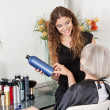 Hairstylist Advising Hair Color To Senior Client — Stock Photo