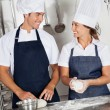 Happy Chefs Kneading Dough In Kitchen — Stock Photo