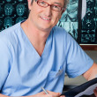 Stock Photo: Male Doctor Holding Clipboard