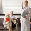 Doctor With In Hospital Lobby — Stockfoto