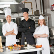 Team Of Confident Chefs In Industrial Kitchen — Stock Photo