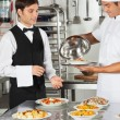 Chef Giving Customer's Food To Waiter — Stock Photo