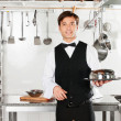 Stockfoto: Young Waiter With Cloche Lid Cover And Tray