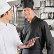 Chef With Colleague Holding Digital Tablet — Stock Photo