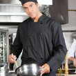 Confident Chef Preparing Food - Stock Photo