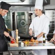 Stock Photo: Chefs Working In Commercial Kitchen