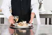 Waiter With Salmon Roll And White Wine — Stock Photo
