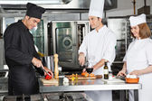 Chefs Working In Commercial Kitchen — Stock Photo