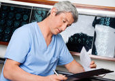 Medical Professional Going Through Document — Stock Photo
