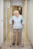 Elderly Woman With Walker In Hospital Corridor — Stock Photo