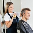 Stock Photo: Hairstylist Setting Client's Hair At Parlor
