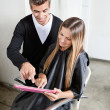 Hairstylist With Client Using Digital Tablet — 图库照片