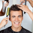 Client With Hairdressers Styling His Hair - Stock Photo