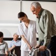 Man Being Assisted By Nurse To Walk Zimmer Frame — Stock Photo