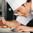 Male Chef Garnishing Dish — Stock Photo #21617605
