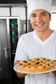 Young Chef Presenting Sweet Dish — Stock Photo