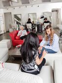 Woman Having Manicure With Customers Waiting At Parlor — Stock Photo