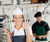Happy Female Chef Gesturing Okay Sign — Stock Photo