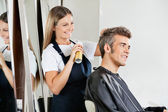 Hairstylist Setting Client's Hair At Parlor — Stock Photo