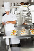 Chef Using Digital Tablet In Kitchen — Stock Photo