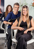 Confident Team Of Hairdressers At Salon — Stock Photo