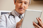 Doctor Using Digital Tablet — 图库照片
