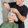 Stock Photo: Hairstylist Cutting Client's Hair In Parlor
