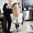 Hairdresser Styling Client's Hair — Stock Photo