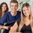 Stock Photo: Team Of Hairdressers At Beauty Parlor