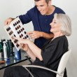 Client And Hairdresser Selecting Hair Color From Catalog — 图库照片