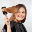 Woman Brushing Hair In Salon — Stock Photo