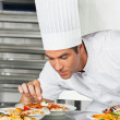 Male Chef Garnishing Pasta Dishes — Stock Photo