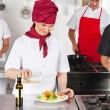 Chefs Working In Kitchen - Stock Photo