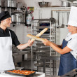 Stock Photo: Chefs Fighting With Bread Loafs