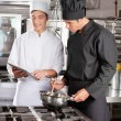Young Chefs With Digital Tablet Preparing Food — Stock Photo #21838441